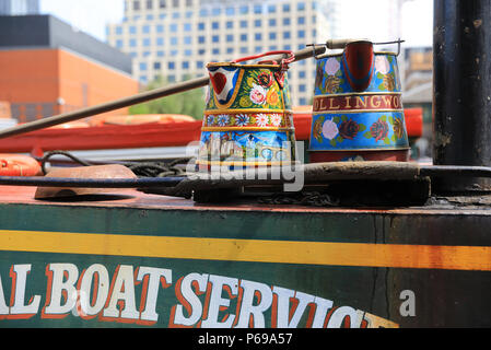 The colourful boats and barges in the attractive Gas Street Basin in Birmingham, in the West Midlands, in the UK - Stock Photo