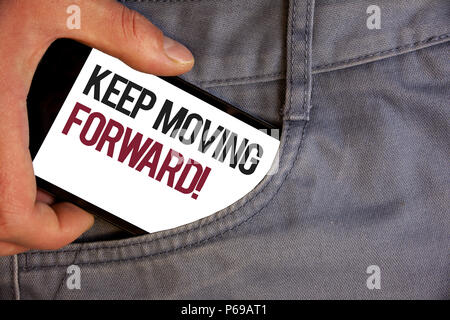Word writing text Keep Moving Forward Motivational Call. Business concept for Optimism Progress Persevere Move Personage hand pushing mobile phone int - Stock Photo