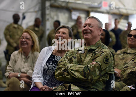 Army Gen. Frank Grass, chief, National Guard Bureau, and his wife, Patricia Grass, enjoy the performance with troops as the general leads the first-ever National Guard USO Tour, Afghanistan, May 19, 2016. (U.S. Army National Guard photo by Sgt. 1st Class Jim Greenhill) (Released) - Stock Photo