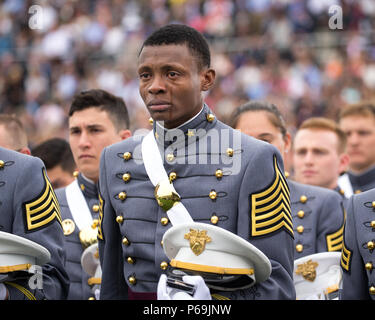 Cadet Alix Idrache sheds tears of joy during the commencement for the U.S. Military Academy's Class of 2016 at Michie Stadium in West Point, May 21.  Nine hundred and fifty-three cadets graduated, which represented approximately 78 percent of the cadets who entered West Point in the summer of 2012. Vice President Joe Biden was the graduation speaker. This is the 218th graduating class of West Point. This class included 151 women, 77 Hispanics, 71 Asian/Pacific Islanders, 69 African-Americans and 12 Native Americans. The class also had 25 combat veterans (24 male, one female).   (U.S. Army phot - Stock Photo
