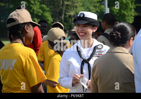 OLD WESTBURY, New York (May 26, 2016) Navy Counselor 1st Class Maria Ciara Tiomico, from Bethpage, New York, intereacting with students during a #FleetWeekNYC Navy aerial demonstration event at Westbury High School. Fleet Week New York, now in its 28th year, is the city's time-honored celebration of the sea services. It is an unparalleled opportunity for the citizens of New York and the surrounding tri-state area to meet Sailors, Marines and Coast Guardsmen, as well as witness firsthand the latest capabilities of today's maritime services. (U.S. Navy photo by Chief Mass Communication Specialis - Stock Photo