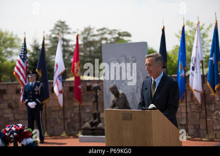 Vermont Governor Peter Shumlin addresses Soldiers and Airmen of the Vermont National Guard, and family members during a Memorial Day Ceremony on Camp Johnson, Colchester, Vt., May 26, 2016. This ceremony gives Soldiers, Airmen, and family members an opportunity to honor those who have paid the ultimate sacrifice in service to their country.  (U.S. Air National Guard photo by Tech. Sgt. Sarah Mattison/Released) - Stock Photo