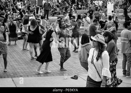 Many couples dance at the Hola Asheville Festival, celebrating Latin American culture, in Asheville, NC, USA - Stock Photo