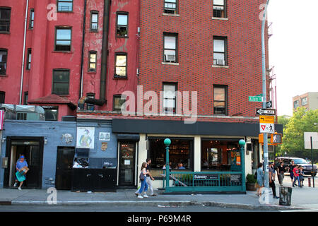 NEW YORK, NY - JUNE 18: 2nd Avenue F/M subway entrance at the corner of Allen and East Houston Street in Lower Manhattan on JUNE 18th, 2017 in New Yor - Stock Photo
