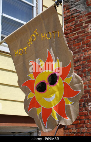 NEW YORK, NY - JUNE 26: HOT HOT HOT! Sunny banner hanged on display outside a house on a sunny summer day in Sunset Park, Brooklyn on JUNE 26th, 2017  - Stock Photo