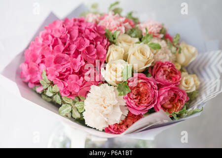 beautiful spring bouquet. flower arrangement with hydrangea and peonies roses. Color light pink. The concept of a flower shop, a small family business - Stock Photo