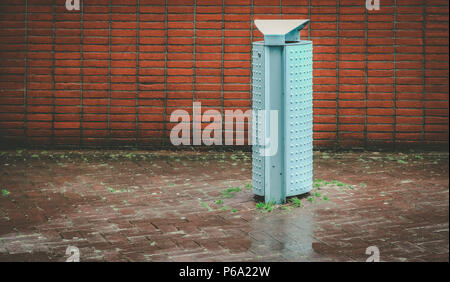 Trashcan on a rainy day in Amsterdam, the Netherlands - Stock Photo