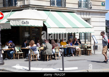 Esmeralda Cafe and Visitors on Ile de La Cite in Paris, France - Stock Photo