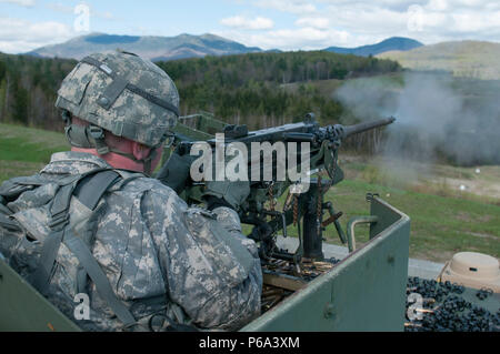 U.S. Army Spc. Troy Blanchard, assigned to Headquarters, Headquarters Troop, 1st Squadron, 172nd Cavalry Regiment (Mountain), Vermont National Guard, fires a .50 Caliber Machine Gun from a HMMWV at Camp Ethan Allen Training Site (CEATS), Jericho, Vt., May 18, 2016. Soldiers qualified on various weapon systems during their annual training at CEATS. (U.S. Army National Guard Photo by Spc. Avery Cunningham/Released) - Stock Photo