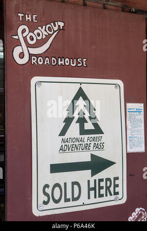 Lookout Roadhouse  on Ortega Hwy displaying the national forest adventure pass for sale  sign. Lake Elsinore California USA - Stock Photo