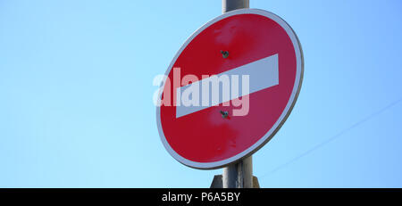 Road sign in the form of a white rectangle in a red circle. No entry . - Stock Photo