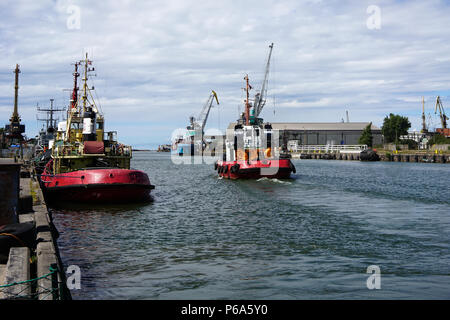 tugboat in the port of Liepaja on the Baltic Sea - Stock Photo