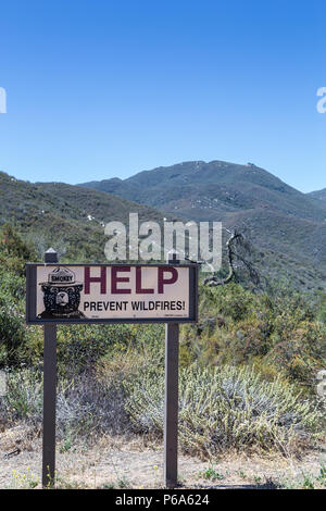 A Smokey Bear warning sign reading Help prevent wildfires in the Cleveland national forest California USA - Stock Photo