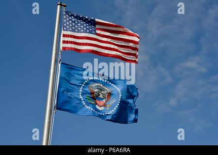 United States national & US Presidential flags, US, Presidential seal on the blue flag, flying over Lyndon B Johnson National Historical Park, TX USA - Stock Photo