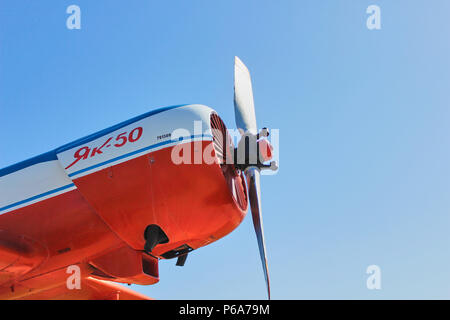 Angle view from below of a old propeller powered soviet plane Yak-50 - Stock Photo
