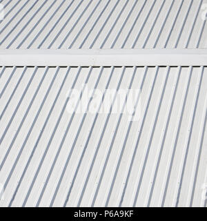Metal gray roof with rhythmic parallel relief directions . - Stock Photo