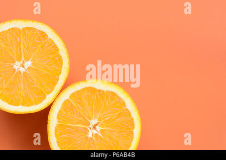 Top view of a several orange fruit slices on bright background in orange color. A saturated citrus texture image . - Stock Photo