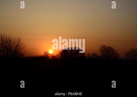 Dawn in the village. Sunrise in the suburban landscape . - Stock Photo