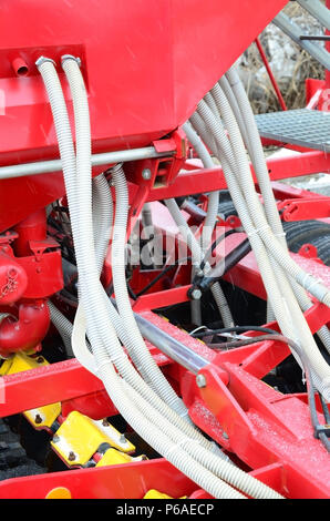 Springs and tubes are arranged in a row. A row of seeder. Heavy equipment on agricultural exhibition . - Stock Photo