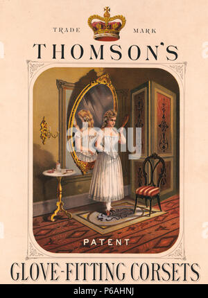 Thomson's glove-fitting corsets - 1874 Advertisement  shows the interior of a room with a young woman standing with her back to a large mirror and holding a small mirror in her left hand with which she can see herself in the larger mirror; she is wearing a Thomson's Trade Mark glove-fitting corset. A large crown appears at the top between the words 'Trade' and 'Mark'. - Stock Photo
