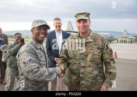 TBILISI, Georgia, May 24, 2016, - Lt. Gen. Ben Hodges, Commanding General, U.S. Army Europe, presents Airman Dasmon Henley, assigned to the 116th Air Control Wing, his coin, acknowledging his efforts during exercise Noble Partner 16 at the Vaziani Training area. - Stock Photo
