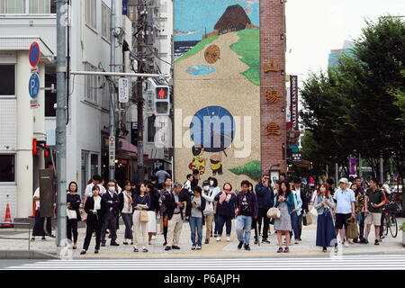 People waiting at a crossing in Tokyo's Omotesando area. (6/2018) - Stock Photo
