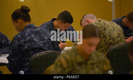 170316-N-OK605-003  MISAWA, Japan (March 16, 2017) Master-at-Arms Seaman Andy Chazerreta, assigned to Naval Air Facility Misawa, takes the Navy-wide E-4 advancement exam. (U.S. Navy Photo by Mass Communication Specialist 2nd Class Samuel Weldin/Released) - Stock Photo