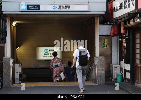 Subway users entering Kagurazaka station which is on the Tozai Line. - Stock Photo