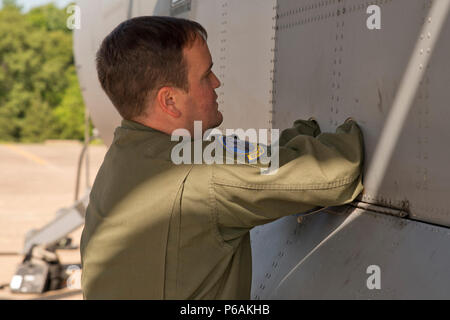 U.S. Air Force Reserve Tech. Sgt. Nick Crawford, loadmaster, 327th Airlift Squadron, inserts a pin to latch down a C-130J landing gear hatch during a preflight inspection at Little Rock Air Force Base, Ark., May 13, 2016. Airmen from the 913th Airlift Group participated in a Turkey Shoot competition with a six aircrews from five units at Little Rock AFB. (U.S. Air Force photo by Master Sgt. Jeff Walston/Released)