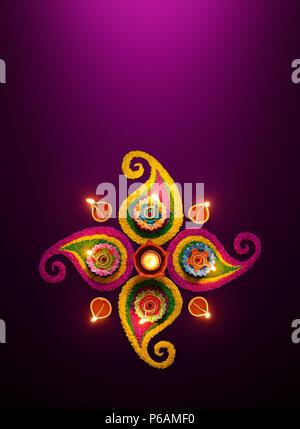 Diwali celebration - Diya oil lamps lit on colorful rangoli - Stock Photo
