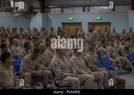 UNDISCLOSED LOCATION, MIDDLE EAST – U.S. Marine Corps Lt. Gen. William D. Beydler, the commander of U.S. Marine Corps Forces Central Command, (center) speaks to Marines with Special Purpose Marine Air-Ground Task Force, Crisis Response-Central Command during a town hall meeting June 22, 2018.  Beydler praised the work Marines have been doing and challenged them to stay ready and continue their mission.  (U.S. Marine Corps photo by Sgt. Royce Dorman) - Stock Photo