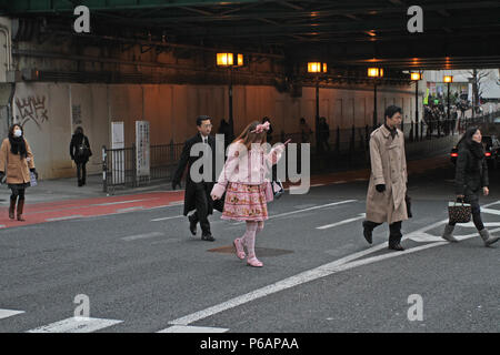 People run for work in Shinjuku financial district inTokyo, Japan – jan 24, 2011. The district is a major commercial and administrative center. Views - Stock Photo