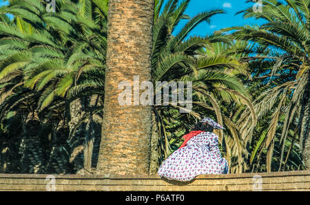 A Herero woman in Swakopmund (Mouth of the Swakop), at the edge of Namib desert on the Atlantic ocean coast of western Namibia, capital of the Erongo  - Stock Photo