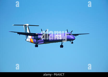 Flybe Dash 8 -400Q Passenger aircraftT approaching Inverness airport in the Scottish Highlands ready for landing. - Stock Photo