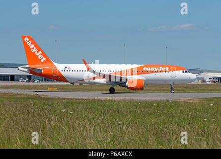 Easyjet flight ready to depart Inverness AIRPORT in the Scottish Highlands on its daily scheduled flight flight south to Gatwick airport London. - Stock Photo