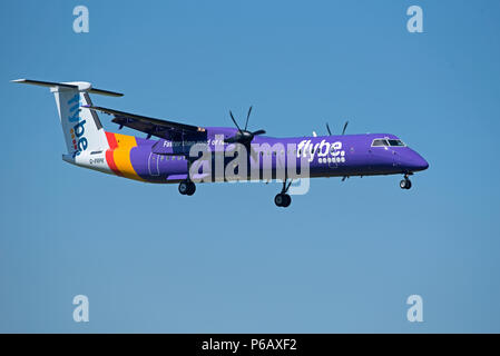 Flybe Dash 8 -400Q Passenger aircraft approaching Inverness airport in the Scottish Highlands ready for landing. - Stock Photo