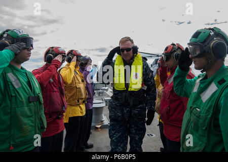 160609-N-JD217-001 BALTIC SEA (June 9, 2016) Vice Admiral James Foggo III, commander, Naval Striking and Support Forces NATO, and commander, U.S. 6th Fleet arrives aboard USS Truxtun (DDG 103) for a visit during Baltic Operations (BALTOPS) June 9, 2016. BALTOPS is an annual recurring multinational exercise designed to improve interoperability, enhance flexibility, and demonstrate the resolve of allied and partner nations to defend the Baltic region. (U.S. Navy photo by Mass Communication Specialist 2nd Class Jessica Echerri-Dupree/Released) - Stock Photo
