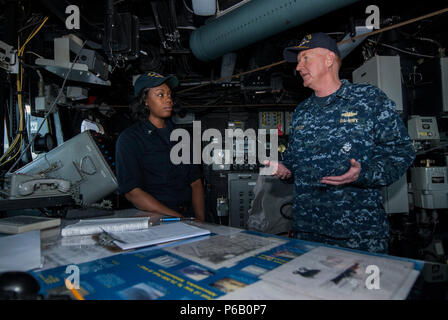 160609-N-JD217-003  BALTIC SEA (June 9, 2016) Vice Admiral James Foggo III, commander, Naval Striking and Support Forces NATO, and commander, U.S. 6th Fleet talks to Quartermaster 3rd Class Asha Holland on the bridge of USS Truxtun (DDG 103) during a visit during Baltic Operations (BALTOPS). BALTOPS is an annual recurring multinational exercise designed to improve interoperability, enhance flexibility, and demonstrate the resolve of allied and partner nations to defend the Baltic region. (U.S. Navy photo by Mass Communication Specialist 2nd Class Jessica Echerri-Dupree/Released) - Stock Photo