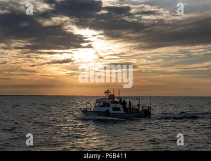161025-N-PB086-0057 PANAMA CITY, Fla. (Oct. 25, 2016) The dive boat attached to the Naval Surface Warfare Center Panama City Division transits out to a test site in the Gulf of Mexico in support of Research, Development, Test and Evaluation projects. (U.S. Navy photo by Ronald Newsome/Released) - Stock Photo