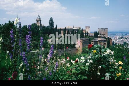 Spain. Granada. The Alhambra. 9th century. View of the walls and towers of the royal enclosure, from the gardens of the Generalife. - Stock Photo