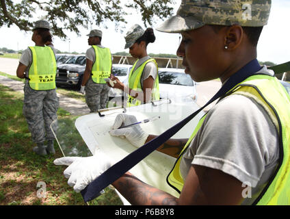 U.S. Air Force Laisha Watkins, 81st Force Support Squadron force management technician and Search and Recovery Team member, plots coordinates of the scene during a major accident response exercise near the triangle track at Keesler Air Force Base, Mississippi, June 21, 2018. The exercise scenario simulated a C-130J Super Hercules in-flight emergency causing a plane crash, which resulted in a mass casualty response event. This exercise tested the base's ability to respond in a crisis situation. (U.S. Air Force photo by Kemberly Groue) - Stock Photo