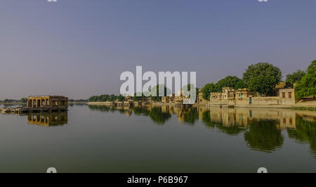 View of Gadsisar Lake with ancient Hindu temples at sunny day in Jaisalmer, India. - Stock Photo