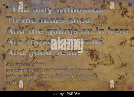 Poland. Krakow. Gestapo Museum. Inscription carved by an unknown prisoner into a wall. Cell n¼. 3.'The only witnesses to the tears shed and the goings-on in here are these for walls and good Jesus'. - Stock Photo