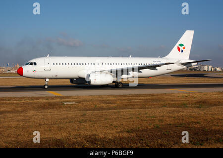Danish Air Transport Airbus A320 passenger jet plane taxiing for departure from Malta. Civil aviation and air travel. - Stock Photo