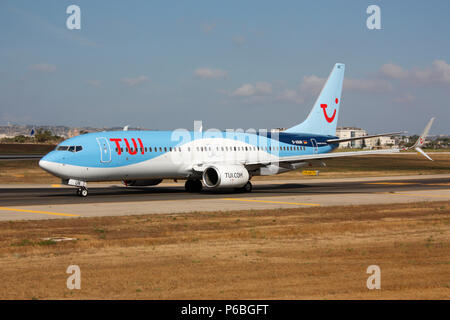 TUI Airways Boeing 737-800 (737NG or Next Generation) passenger jet plane taxiing on airport taxiway before departure from Malta. Modern aviation. - Stock Photo