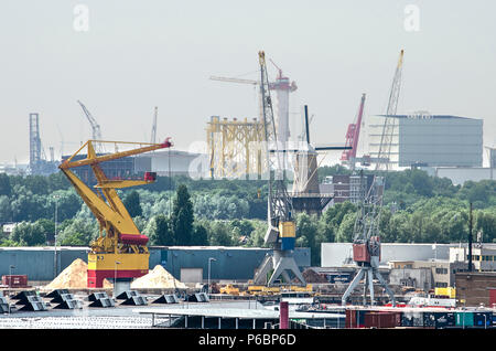 Rotterdam, The Netherlands, June 3, 2018: view of the  industrial areas of Merwe Vierhavens and Schiedam with harbour cranes and other equipment as we - Stock Photo