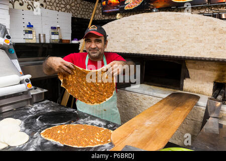 Pizza chef preparing pizzas in front of the pizzeria oven at Moo's Kebab, Moo's Kebab, Gzira, Island of Malta, Malta. It is a Turkish kebab restaurant. (91) - Stock Photo