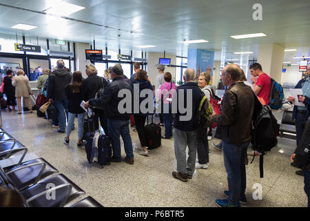 Easyjet passengers in queue / queuing / queues / waiting to board a plane at departure gate 15 at Malta International Airport. (91) - Stock Photo