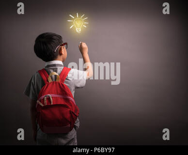 Elementary school kid student drawing doodle with child's imagination for national back to school month, education concept - Stock Photo
