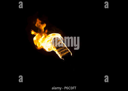 flame of a torch in the dark on a black background, only the fire is visible - Stock Photo
